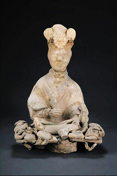 中国最早的饺子啥样子 三峡博物馆东汉女厨俑上有答案